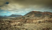 Volcanic landscape and the sea — Stock Photo