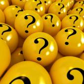 Yellow spheres with question marks — Stock Photo