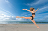 Woman flying in a graceful jump — Stock Photo