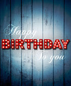 Glowing Happy Birthday on wooden background — Foto de Stock