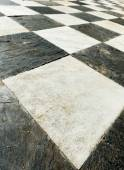 Ancient checkered floor close up — Foto Stock