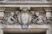 Medallion and cherubs — Stock Photo