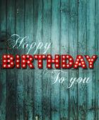 Glowing Happy Birthday on wooden background — ストック写真
