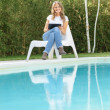 Woman by the pool with tablet — Stock Photo #66267045