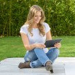Woman by the pool with tablet — Stock Photo #66267345