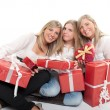 Three happy sisters with presents — Stock Photo #66267639