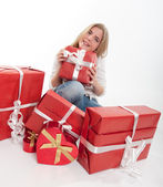Thrilled teenager with presents — Stock Photo