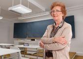 Senior lady in a classroom — Stock Photo