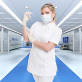 Nurse with shot in a hospital — Stock Photo