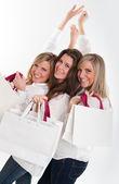 Three happy shoppers — Stock Photo