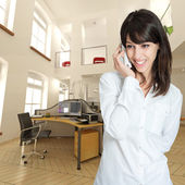 Woman on the phone at the office — Stock Photo