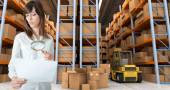Woman verifying document in warehouse — Stock Photo