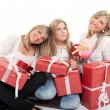 Three lovely sisters with presents — Stock Photo #66272821