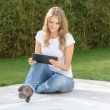 Woman by the pool with tablet — Stock Photo #66273855
