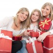 Three beautiful sisters with presents — Stock Photo #66274771