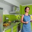 Smiling cook in a modern kitchen — Stock Photo #66275417