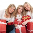 Three sisters with presents — Stock Photo #66276487