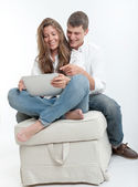 Young couple and tablet  — Stok fotoğraf