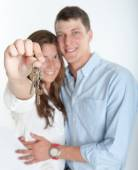 Loving couple and keys — Stock Photo