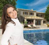 Young woman in luxury house — Stock Photo