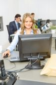Woman at her office desk — Stock Photo