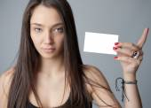 Young woman holding card — Stock Photo