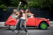Girls having fun on the road — Stock Photo