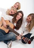 Happy girls singing — Stock Photo