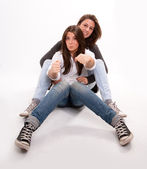 Mother and teenage daughter playing around — Stock Photo