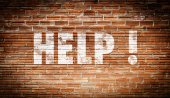 Help on brick wall — Stockfoto