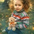 Girl hugging a teddy bear — Stock Photo #53973223
