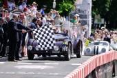 A dark red Alfa Romeo 6C 2300 B MM spider touring finishes the 1000 Miglia classic car race — Stock Photo
