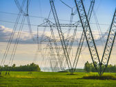 High-voltage masts in the field — Stock Photo