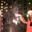 Happy kids with sparklers celebrating christmas outdoors — Stock Video #70983703