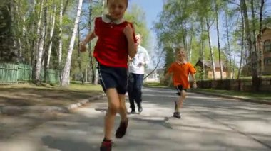 Healthy family - happy children and their mother running outdoors — Stock Video