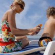 Young beautiful mother applying sunscreen on son's back — Stock Video #76566995