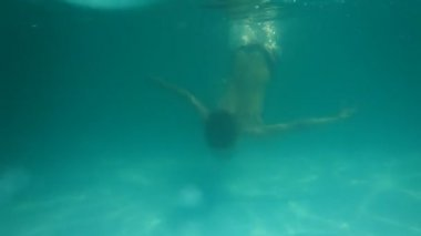 Boy diving in swimming pool outdoors. — Stock Video