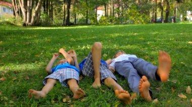 Three boys having fun on the grass — Stockvideo