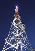 Illuminated broadcast tower — Stock Photo