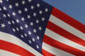 United States flag over blue sky — Stock Photo