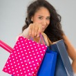 Attractive woman with shopping bags — Stock Photo #55919063