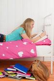 Making homework on bed — Fotografia Stock