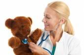 Pediatrician with stuffed bear — Stock Photo