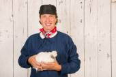 Farmer with chicken — Stock Photo