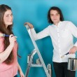 Young couple painting house — Stock fotografie #61340315