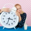 Woman with insomnia and big alarm clock — Stock Photo #63329493