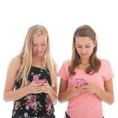 Teenager girls with smartphone — Stock Photo