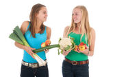 Teen girlfriends with fresh vegetables and fruit — Stock Photo