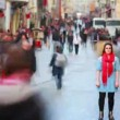 Woman posing on busy street, timelapse — Stock Video