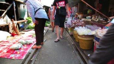 Train passing through folding umbrella market — Stock Video